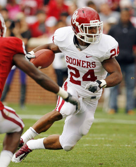 Brennan Clay (24) carries during the University of Oklahoma (OU) football team's annual Red and White Game at Gaylord Family/Oklahoma Memorial Stadium on Saturday, April 14, 2012, in Norman, Okla.  Photo by Steve Sisney, The Oklahoman