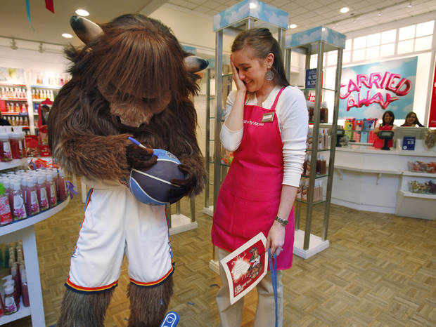 Greg Rosino surprised his wife Krystale at work when Thunder Mascot Rumble delivered a Valentine Surprise on Saturday, February 12, 2011, in Norman, Okla.   Photo by Steve Sisney, The Oklahoman