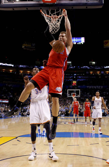 Los Angeles Clippers' Blake Griffin (32) dunks the ball in front of Oklahoma City's Kevin Durant (35) during the NBA basketball game between the Oklahoma City Thunder and the Los Angeles at the Oklahoma City Arena, Wednesday, April 6, 2011. Photo by Bryan Terry, The Oklahoman