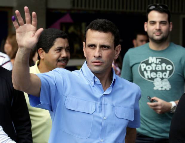 Miranda's  Gov. Henrique Capriles waves to supporters after casting his ballot at a polling station in Caracas, Venezuela, Sunday, Dec. 16, 2012. Venezuelans are choosing governors and state lawmakers  in elections that have become a key test of whether President Hugo Chavez's movement can endure if the socialist leader leaves the political stage. (AP Photo/Fernando Llano)