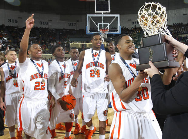 Douglass' Dorrian Williams (30) is handed the gold ball trophy after the Trojans defeated Bridge Creek during the championship game of the 4A boys state championship tournament at the Big House in the State Fair Park on Saturday, March 12, 2011, in Oklahoma City, Okla.   Photo by Chris Landsberger, The Oklahoman
