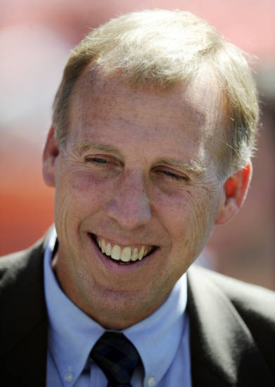 FILE - In this Sept. 19, 2010, file photo, John Idzik, Seattle Seahawks vice president of football administration, looks on prior to an NFL football game against the Denver Broncos in Denver. The New York Jets hired Idzik on Friday, Jan. 18, 2013, to be their general manager, ending a search that included 10 candidates and lasted nearly three weeks. (AP Photo/Jack Dempsey, File)