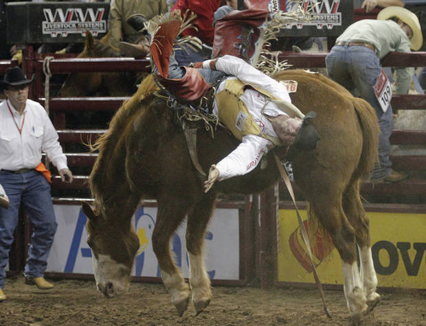 DV Fennell, of Porum, Okla., competes in Bareback Bronc during the final performance of International Finals Rodeo at the State Fair Arena in Oklahoma City, Okla., Sunday, Jan. 20, 2013.  Photo by Garett Fisbeck, For The Oklahoman