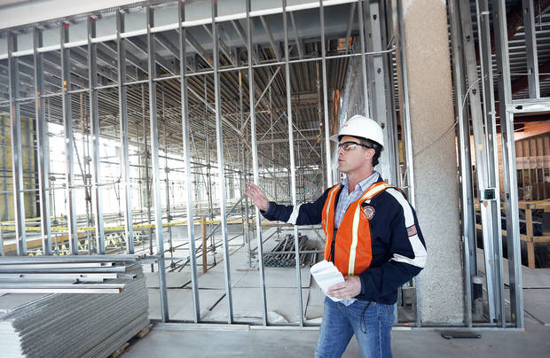 Left: David Huslig, sports medicine and physical therapy director at  Mercy, talks about construction at the Mercy Health Edmond site in Edmond.  Photo by Sarah Phipps, The Oklahoman