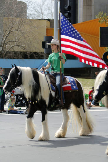 "Macey Murselley carried the flag for ""Deerinwater Farms"", during the annual Saint Patrick's Day Parade in downtown Oklahoma City, OK, Saturday, March 16, 2013,  By Paul Hellstern, The Oklahoman"