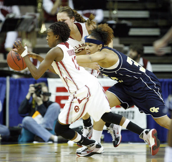Danielle Robinson steels the ball from Iasia Heminway in the first half as the University of Oklahoma (OU) plays Georgia Tech in round two of the 2009 NCAA Division I Women's Basketball Tournament at Carver-Hawkeye Arena at the University of Iowa in Iowa City, IA on Tuesday, March 24, 2009. 