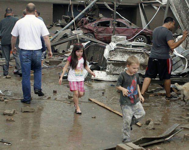Children run out from the remains of Briarwood Elementary school after a tornado destroyed the school in south OKC Oklahoma City, OK, Monday, May 20, 2013. Near SW 149th and Hudson.  By Paul Hellstern, The Oklahoman