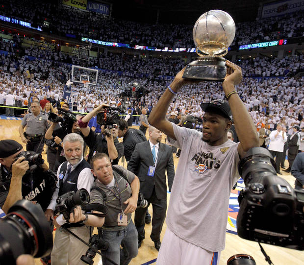 Oklahoma City's Kevin Durant holds the trophy after Game 6 of the Western Conference Finals between the Oklahoma City Thunder and the San Antonio Spurs in the NBA playoffs at the Chesapeake Energy Arena in Oklahoma City, Wednesday, June 6, 2012. Oklahoma City won 107-99. Photo by Bryan Terry, The Oklahoman