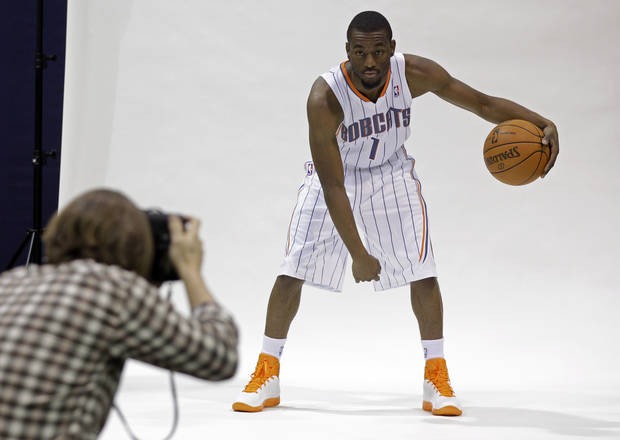 Charlotte Bobcats' Kemba Walker, right, poses for a photographer during NBA basketball media day in Charlotte, N.C., Thursday, Dec. 15, 2011. (AP Photo/Chuck Burton)