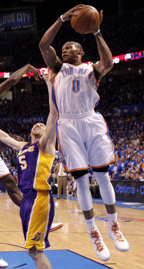 Oklahoma City's Russell Westbrook (0) looks to pass beside Los Angeles' Steve Blake (5) during Game 1 in the second round of the NBA playoffs between the Oklahoma City Thunder and L.A. Lakers at Chesapeake Energy Arena in Oklahoma City, Monday, May 14, 2012. Photo by Bryan Terry, The Oklahoman