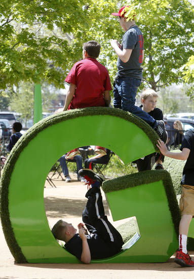 Children play on a letter sculpture in the kid's area during the Festival of the Arts in downtown Oklahoma City, OK, Thursday, April 25, 2013,  By Paul Hellstern, The Oklahoman