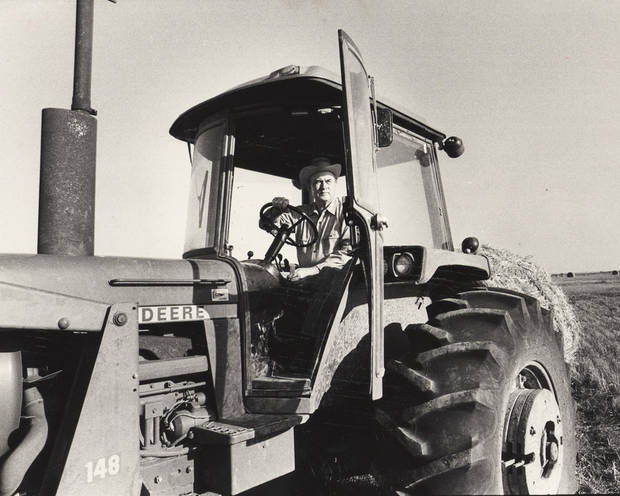 Former Gov. Henry Bellmon is shown working on his farm in 1980. OKLAHOMAN ARCHIVE PHOTO