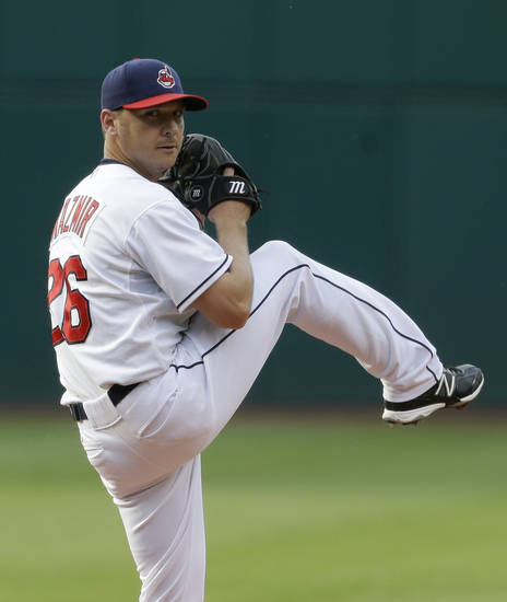 Cleveland Indians starting pitcher Scott Kazmir delivers a pitch in the first inning of a baseball game against the Minnesota Twins, Friday, June 21, 2013, in Cleveland. (AP Photo/Tony Dejak)