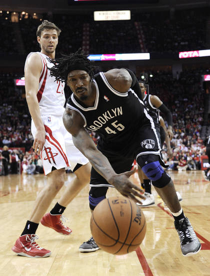 Brooklyn Nets' Gerald Wallace (45) chases a loose ball as Houston Rockets' Chandler Parsons (25) watches during the second half of an NBA basketball game Saturday, Jan. 26, 2013, in Houston. The Rockets won 119-106. (AP Photo/Pat Sullivan)