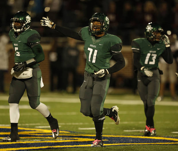 Santa Fe's Chase Hillmon (71) celebrates with his teammates during a high school football game between Edmond Memorial and Edmond Santa Fe at Wantland Stadium in Edmond, Okla., Friday, Oct. 26, 2012.  Photo by Garett Fisbeck, The Oklahoman