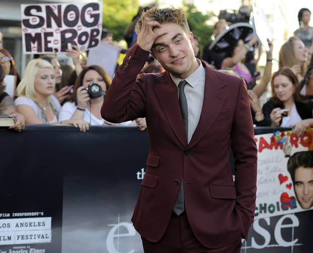 "Actor Robert Pattinson arrives at the premiere of ""The Twilight Saga: Eclipse"" on Thursday, June 24, 2010 in Los Angeles.  (AP Photo/Chris Pizzello) ORG XMIT: CASH142"
