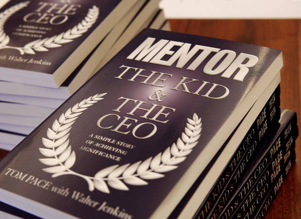 Oklahoma City business executive Tom Pace's book about mentoring was distributed to all students and mentors who attended a mentoring session in the school's library on  Saturday, Sep. 8,  2012.  Volunteers from throughout the community are dedicating their weekends and afternoons to mentor boys in seventh grade at John Marshall High School. The idea is called Project BOLD: Bridging Opportunities for Leadership Development.  Photo by Jim Beckel