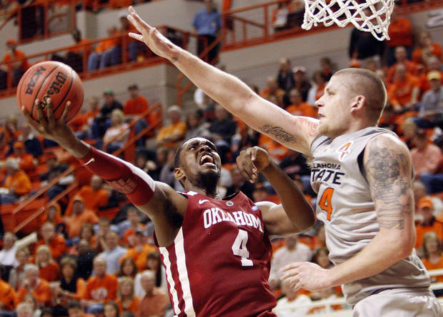 OU's Andrew Fitzgerald (4) tries to get a shot past OSU's Philip Jurick (44) in the first half during the Bedlam men's college basketball game between the Oklahoma State University Cowboys and the University of Oklahoma Sooners at Gallagher-Iba Arena in Stillwater, Okla., Monday, Jan. 9, 2012. Photo by Nate Billings, The Oklahoman
