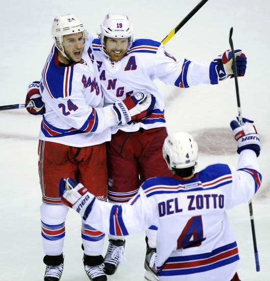 New York Rangers right wing Ryan Callahan (24) celebrates his goal with Michael Del Zotto (4) and Brad Richards (19) during the second period against the Washington Capitals in Game 3 of their NHL hockey Stanley Cup second-round playoff series at the Verizon Center in Washington, Wednesday, May 2, 2012. (AP Photo/Susan Walsh)