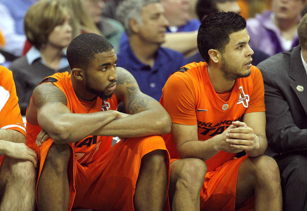 Oklahoma's Michael Cobbins (20) and Cezar Guerrero (1) watch the final seconds of the Big 12 tournament men's basketball game between the Oklahoma State Cowboys and Missouri Tigers the Sprint Center, Thursday, March 8, 2012. Photo by Sarah Phipps, The Oklahoman