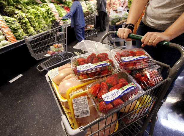 A shopper�s basket is filled with groceries at Sunflower Farmers Market on Second Street in Edmond. The store opened Wednesday. Photos by Jim Beckel, The Oklahoman