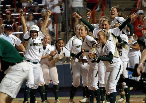 Baylor celebrates a walk-off home run by Holly Holl (6) during the Women's College World Series game between Baylor and Missouri at the ASA Hall of Fame Stadium in Oklahoma City, Sunday, June 5, 2011. Photo by Sarah Phipps, The Oklahoman