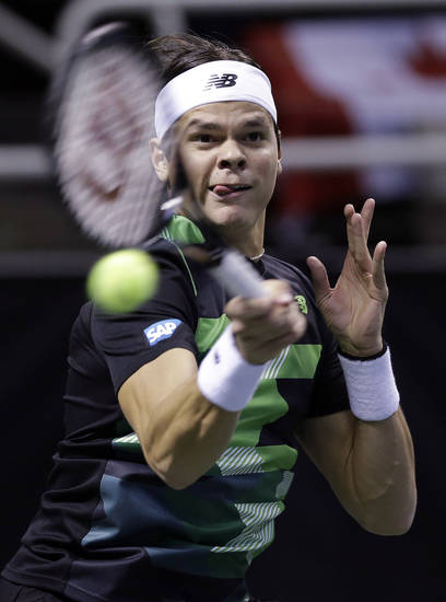 Milos Raonic, of Canada, returns to Denis Istomin, of Uzbekistan, during the SAP Open tennis tournament in San Jose, Calif., Friday Feb. 15, 2013. (AP Photo/Marcio Jose Sanchez)
