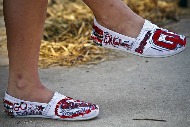 A Sooner fan wears her decorated shoes on game day during the college football game between the University of Oklahoma Sooners (OU) and the Tulsa University Hurricanes (TU) at the Gaylord Family-Memorial Stadium on Saturday, Sept. 3, 2011, in Norman, Okla. 
