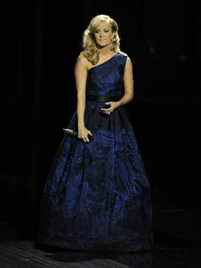 "Carrie Underwood performs ""Yesterday"" by The Beatles at the 65th Primetime Emmy Awards at Nokia Theatre on Sunday Sept. 22, 2013, in Los Angeles. (AP)"