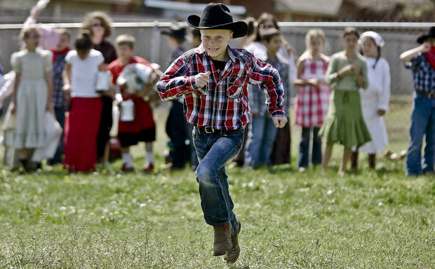 Sooner Preston Reed takes off to try an get an early claim during the Oklahoma Land Run celebration at Mustang Trails Elementary on Monday, April 22, 2013, in Mustang, Okla.   Photo by Chris Landsberger, The Oklahoman