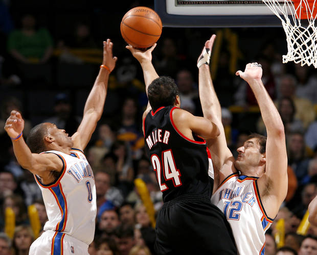 Oklahoma City's Russell Westbrook and Nenad Krstic (right) combine to pressure a shot by Portland's Andre Miller during their NBA basketball game at the Ford Center in Oklahoma City, Okla., on Sunday, March 28, 2010. Photo by John Clanton, The Oklahoman