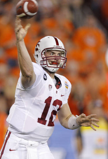 Stanford's Andrew Luck (12) throws a pass during the Fiesta Bowl between the Oklahoma State University Cowboys (OSU) and the Stanford Cardinal at the University of Phoenix Stadium in Glendale, Ariz., Monday, Jan. 2, 2012. Photo by Bryan Terry, The Oklahoman