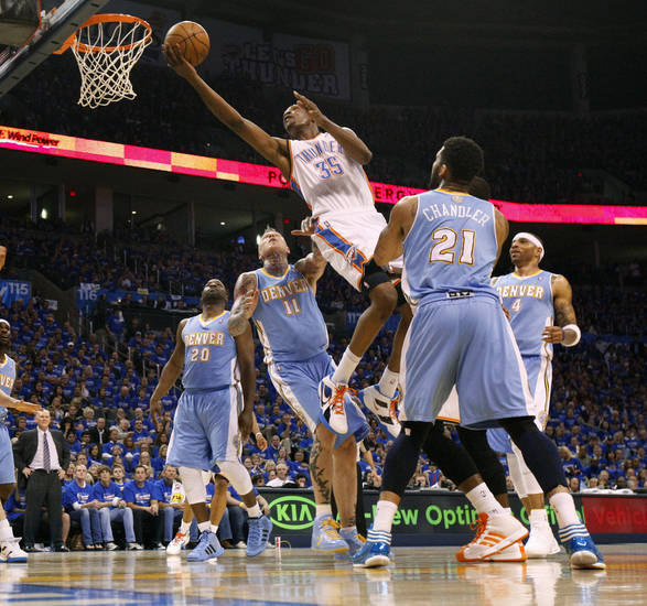 Oklahoma City's Kevin Durant (35) goes to the basket between Denver's Raymond Felton (20), Chris Andersen (11), Kenyon Martin (4), and Wilson Chandler (21) during the NBA basketball game between the Denver Nuggets and the Oklahoma City Thunder in the first round of the NBA playoffs at the Oklahoma City Arena, Sunday, April 17, 2011. Photo by Bryan Terry, The Oklahoman