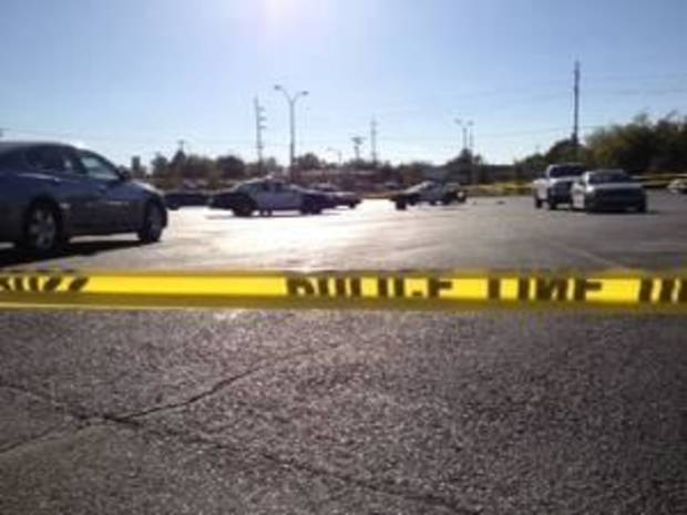 Oklahoma City police investigate an officer-involved shooting Thursday in the parking lot of Buy For Less, 415 SW 59. Photo by Sarah Phipps, The Oklahoman.