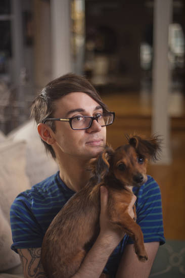 Christian Siriano holds Bear at his New York City apartment, September 11, 2012. (Karl Merton Ferron/Baltimore Sun/MCT)