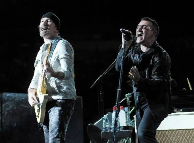 Guitarist The Edge, left, and lead singer Bono of the rock band  U2 perform with the band during their 360 world tour stop at Giants Stadium in East Rutherford, NJ on Thursday, Sept. 24, 2009. (AP Photo/Evan Agostini)
