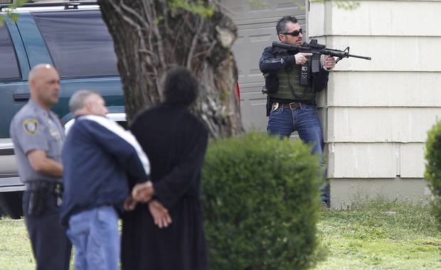 Police take a suspect into custody in connection to the robbery of MidFirst Bank in Oklahoma City , Friday April 12, 2013. Oklahoma City Police and FBI agents surounded a home at 3024 NE 16th street. Photo By Steve Gooch, The Oklahoman