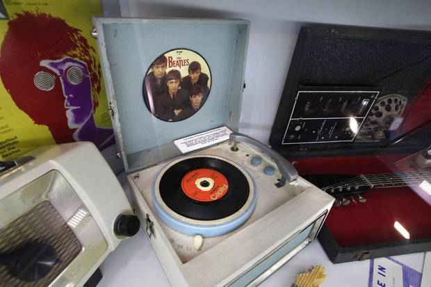 "Beatles memorabilia and various music players are included in the ""decade pods"" inside ""The Science of Rock 'n' Roll"" exhibit, now on view at Science Museum Oklahoma. Photo by Paul Hellstern, The Oklahoman"