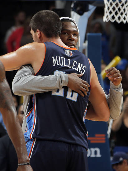 Oklahoma City's Kevin Durant (35) greets Charlotte's Byron Mullens (22) following the preseason NBA game between the Oklahoma City Thunder and the Charlotte Bobcats at Chesapeake Energy Arena in Oklahoma City, Tuesday, Oct. 16, 2012. Photo by Sarah Phipps, The Oklahoman