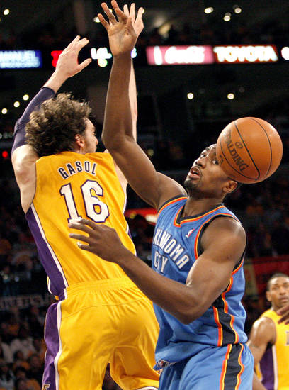 Los Angeles' Pau Gasol (16) and Oklahoma City's Serge Ibaka (9) go after a loose ball during Game 3 in the second round of the NBA basketball playoffs between the L.A. Lakers and the Oklahoma City Thunder at the Staples Center in Los Angeles, Friday, May 18, 2012. Photo by Nate Billings, The Oklahoman