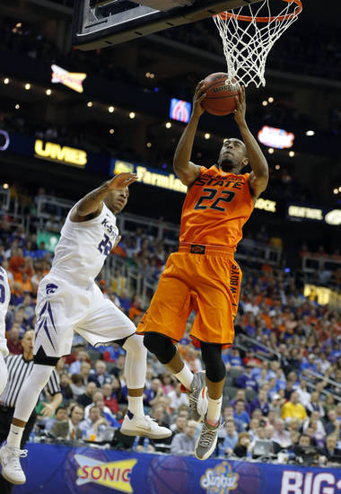 Oklahoma State's Markel Brown (22) shoots as Kansas State's Rodney McGruder (22) defends during the Phillips 66 Big 12 Men's basketball championship tournament game between Oklahoma State University and Kansas State at the Sprint Center in Kansas City, Friday, March 15, 2013. Photo by Sarah Phipps, The Oklahoman