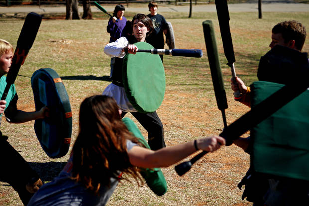 Mark Jones, left, fights as he practices Dagorhir battle games at E.C. Hafer Park. A group of Dagorhir players meet on Saturdays in the park. PHOTO BY BRYAN TERRY, THE OKLAHOMAN. <strong>BRYN TERRY - THE OKLAHOMAN</strong>
