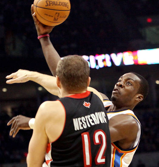 Oklahoma City's Jeff Green throws a pass backward to Nick Collison in fron of pressure from Toronto's Rasho Nesterovic during their NBA basketball game at the Ford Center in Oklahoma City on Sunday, Feb. 28, 2010. Photo by John Clanton, The Oklahoman