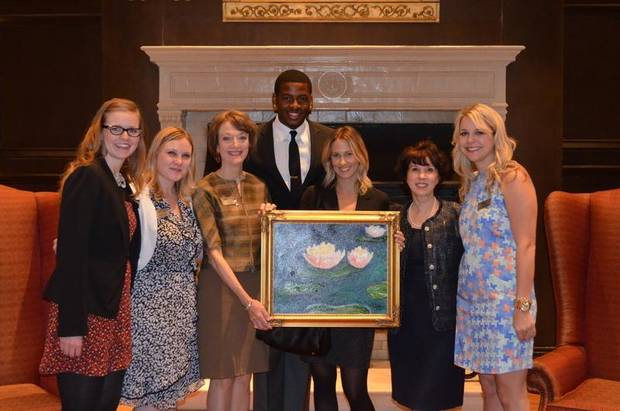 5: (OKC Beautiful staff with event chairs and the Desmond Mason piece that was raffled off) Kasey Steffen, Melissa Brodt, Lisa Synar, Desmond Mason, Andrea Mason, Mary Blankenship Pointer, Juliann Strange. Photo provided__