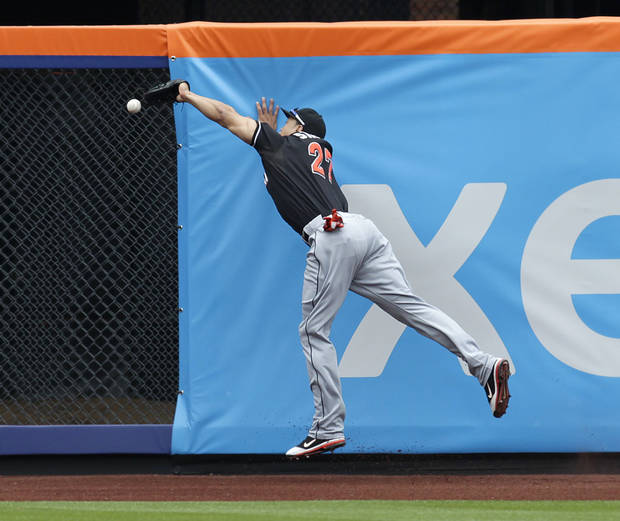Miami Marlins right fielder Giancarlo Stanton is unable to make a catch on a triple hit by New York Mets' Kirk Nieuwenhuis during the first inning of a baseball game, Thursday, April 26, 2012, at Citi Field in New York. (AP Photo/Seth Wenig).