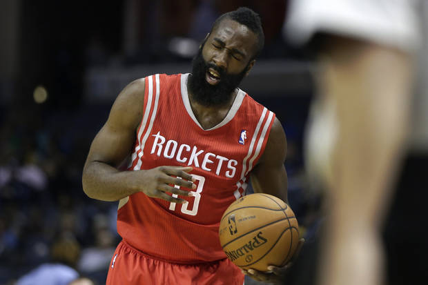 Houston Rockets' James Hardenreacts after being hurt during the first half of an NBA preseason basketball game against the Memphis Grizzlies in Memphis, Tenn., Friday, Oct. 25, 2013. (AP Photo/Danny Johnston)