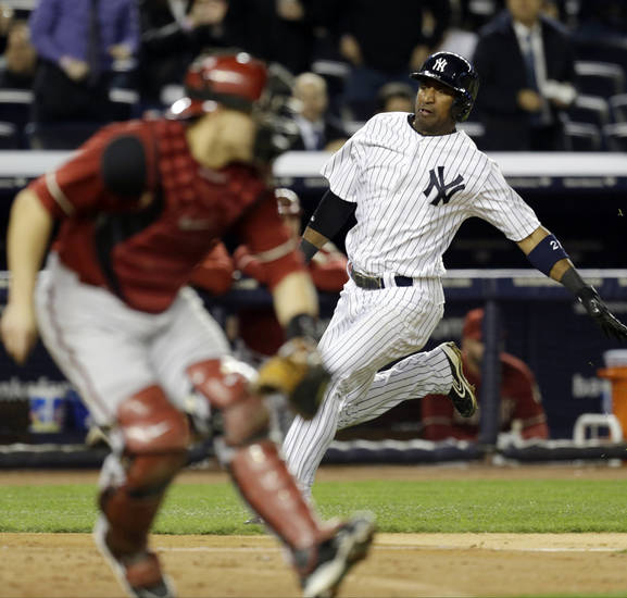 New York Yankees' Eduardo Nunez scores on Brett Gardner's seventh-inning, two-run single as Arizona Diamondbacks catcher Miguel Montero leaves the plate uncovered in the Yankees' 4-3 win in a baseball game at Yankee Stadium in New York, Wednesday, April 17, 2013. (AP Photo/Kathy Willens)