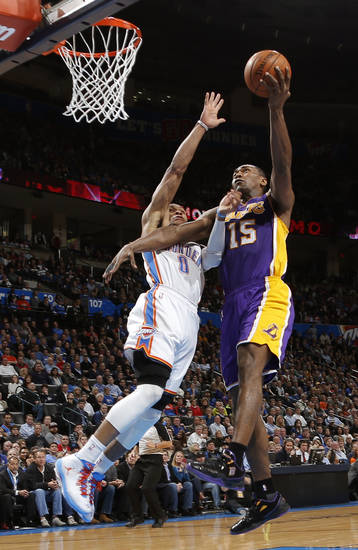 Oklahoma City's Russell Westbrook (0) defends Los Angeles' Metta World Peace (15) during an NBA basketball game between the Oklahoma City Thunder and the Los Angeles Lakers at Chesapeake Energy Arena in Oklahoma City, Tuesday, March. 5, 2013. Photo by Bryan Terry, The Oklahoman