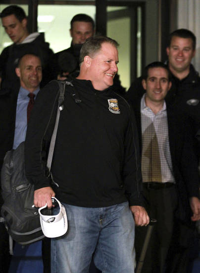 Chip Kelly arrives at Northeast Philadelphia Airport, Wednesday, Jan. 16, 2013, in Philadelphia. Oregon's enigmatic NCAA college football head coach of four years surprised the school with an early morning phone call Wednesday to say he was leaving to become head coach of the Philadelphia Eagles NFL football team, just a little more than a week after he told Oregon he was staying. (AP Photo/The Philadelphia Inquirer, David Swanson)  PHIX OUT; TV OUT; MAGS OUT; NEWARK OUT