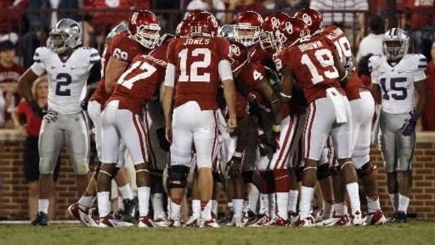 Oklahoma's Landry Jones (12) huddles up the team for a two-point conversion attempt during the college football game between the University of Oklahoma Sooners (OU) and the Kansas State University Wildcats (KSU) at the Gaylord Family-Oklahoma Memorial Stadium on Saturday, Sept. 22, 2012, in Norman, Okla. Photo by Chris Landsberger, The Oklahoman